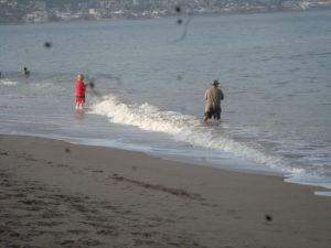 A couple of fisherman enjoying the beach before the crowds arrive.