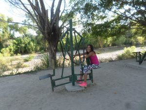 My nieces daughter tries out some of the exercise equipment